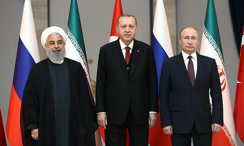 الرؤساء رجب طيب أردوغان وفلاديمير بوتين وحسن روحاني (الأناضول)