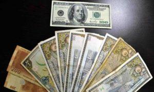 صورة تعبيرية، توضيح لمدى تدهور الليرة السورية مقابل الدولار الأمريكي - (الأناضول)