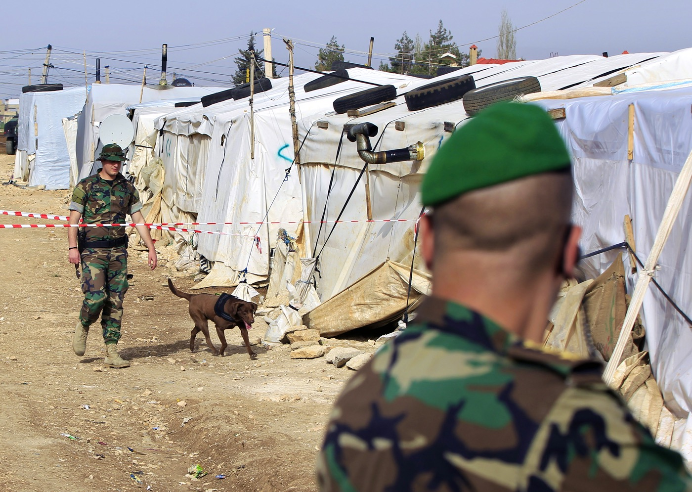 Lebanese soldiers in a refugee camp in the Syrian town of al-Dalhamiyya in the Beqaa before a visit by a senior official (AP)