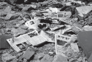 Copies of Enab Baladi newspaper's 45 issue among the debris of a destroyed building in the city of Daraya, rural Damascus (December 2013) photo credit: Enab Baladi