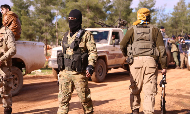 Members of the National Liberation Front (آ/[) as they set off for Tel Mannas - 4 January 2018 (Medad Press)