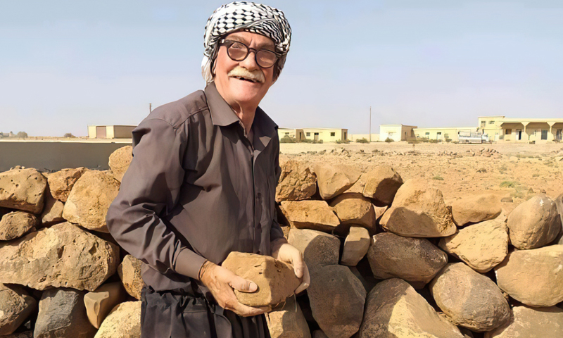 An old man building a wall for his house in As-Suwayda city- 2020 (Suwayda24)