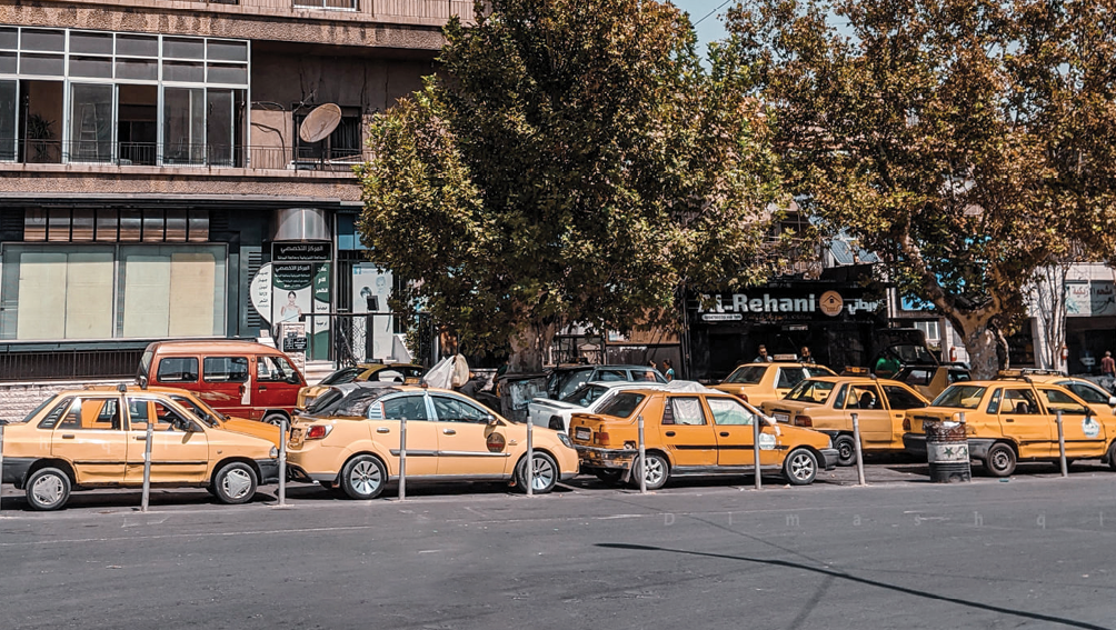 A long line of cars waiting to be re-filled with fuel in front of a fuel station in Damascus - September 2020 (Photo by Lens of a Young Damascene Man)