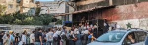 Under the consumer protection signs, a queue of citizens in front of the door of the ٍState Bakery Company in the city of Damascus -22 July 2020 (Lens of young Damascene)