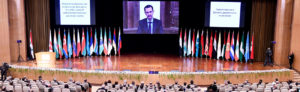 "The head of the Syrian Regime addresses the audience via a video call due to the spread of ""Covid-19"" during the ""refugees return"" conference in the Syrian capital, Damascus under the supervision and organization of Russia - 11 November 2020 (Syrian News Agency ""SANA"")"