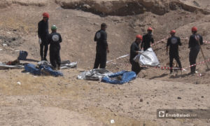 The First Response Team exhuming bodies from mass graves in Raqqa - September 2020 (Enab Baladi- Hussam al-Omar)
