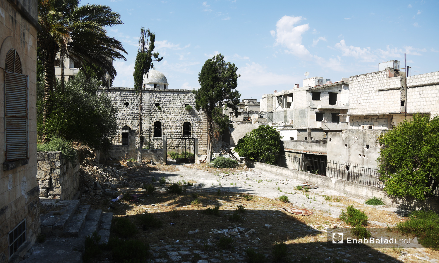 """Mar Georges"" Church for the Greek Orthodox in Jisr al-Shughur city in the Southern Idlib countryside still has its structure despite being bombed during the war years in Syria – July 2020 (Enab Baladi)"
